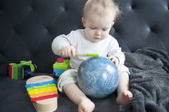 Baby with toys Royalty Free Stock Photo