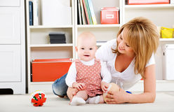 Baby playing with toys with happy mother Royalty Free Stock Photos