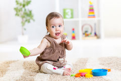 Baby playing with toys indoor Stock Photos