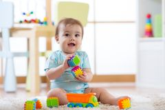 Baby playing toys in nursery or daycare royalty free stock image