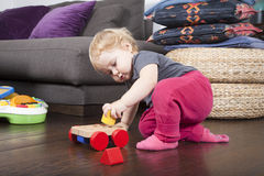 Baby playing with toys Stock Photos