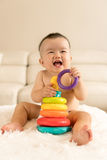 Baby playing toys Stock Images