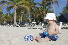 Baby Playing on Tropical Beach. Baby boy playing in sand on a tropical beach Stock Photography