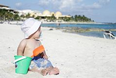Baby Playing on Tropical Beach. Baby boy playing in sand on a tropical beach Stock Photos
