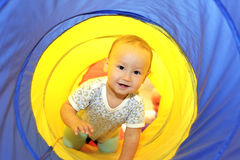 Baby playing in tube Royalty Free Stock Photography