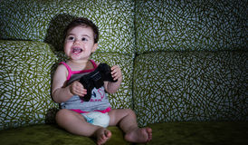 Baby playing video games Royalty Free Stock Images