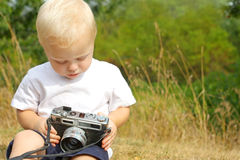Baby Playing with Vintage Camera Stock Photography