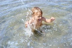 Baby playing in water. Happy baby playing in water Stock Photography