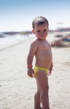 Baby playing in the water at the beach, Italy Royalty Free Stock Photo