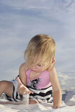 Baby playing in white sand Stock Photography