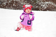 Baby playing in winter Stock Photography
