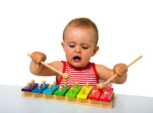 Baby playing xylophone Stock Photo