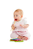 Baby playing with xylophone Royalty Free Stock Photography
