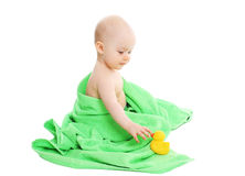 Baby playing with yellow rubber duck Royalty Free Stock Photos