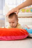 Baby on playmat concentrating Stock Images