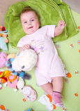 Baby in playpen. Happy baby girl in colorful playpen with toys Stock Photos