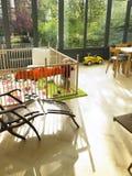 Baby in Playpen in Living Room. Vertically framed shot Stock Image