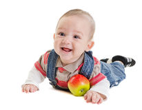 Baby plays with apple Stock Images