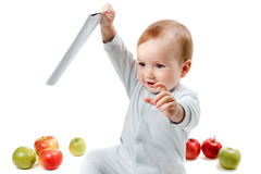 Baby plays with apples. Studio Portrait , isolated on a white background Royalty Free Stock Image