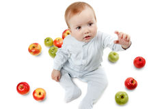 Baby plays with apples. Studio Portrait , isolated on a white background Stock Photography