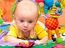 Baby plays in baby gym Royalty Free Stock Photo
