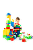 Baby plays with blocks Stock Images