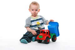 Baby plays with car. Boy child plays with a toy car Royalty Free Stock Image