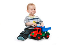 Baby plays with car Stock Image