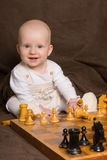Baby plays chess Royalty Free Stock Image