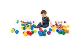Baby plays with color balls Stock Photography