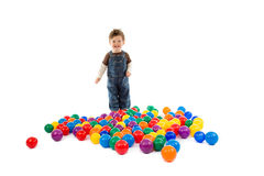 Baby plays with color balls Stock Photo