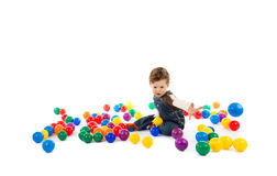 Baby plays with color balls Royalty Free Stock Image