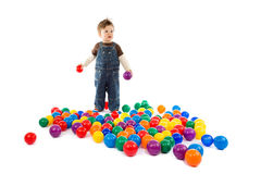 Baby plays with color balls Stock Image