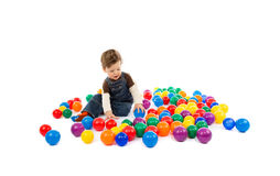 Baby plays with color balls Royalty Free Stock Photos