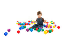 Baby plays with color balls Stock Photos