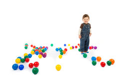 Baby plays with color balls Royalty Free Stock Photography