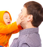 Baby plays with dad. Laughing baby plays with dad, isolated Royalty Free Stock Images