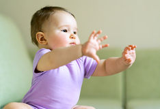 Baby plays and doing gymnastics Royalty Free Stock Photos