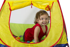 Baby plays in a Jimmy Stock Images