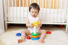 Baby plays nesting blocks Royalty Free Stock Photo