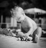Baby plays in the pool. Baby plays in the swimming pool alone Royalty Free Stock Image