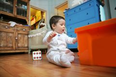 Baby plays in the room, soft focus royalty free stock photography