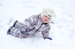 Baby plays in snow Royalty Free Stock Photo