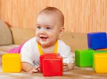 Baby  plays with toy blocks Royalty Free Stock Photo