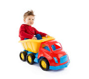 Baby plays with toy truck Stock Image