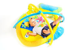Baby plays with toys Royalty Free Stock Photo