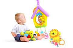 Baby plays with toys Stock Photos