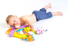 Baby plays with toys Stock Images