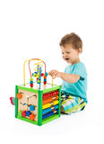 Baby plays with toys Stock Photo