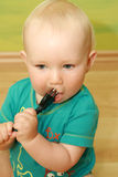Baby with plug Royalty Free Stock Image